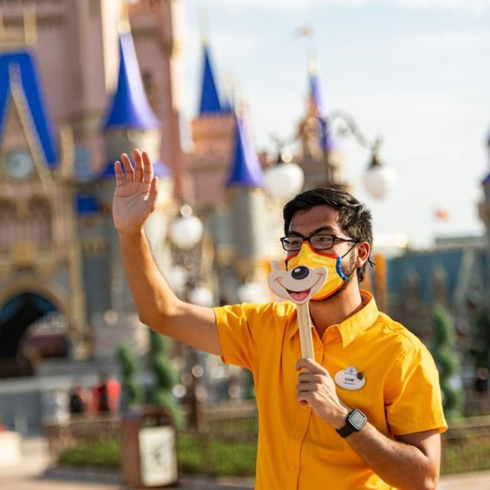LAKE BUENA VISTA, FL - JULY 11: In this handout photo provided by Walt Disney World Resort, a Disney cast member welcomes guests to Magic Kingdom Park at Walt Disney World Resort on July 11, 2020 in Lake Buena Vista, Florida. July 11, 2020 is the first day of the phased reopening. (Photo by Matt Stroshane/Walt Disney World Resort via Getty Images)