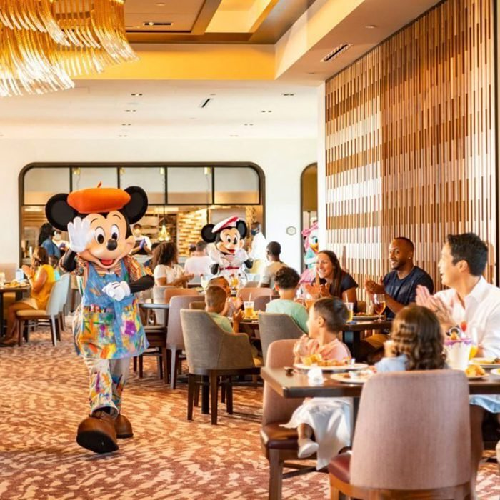 LAKE BUENA VISTA, FL - JUNE 23: In this handout photo provided by Walt Disney World Resort, guests at Disney's Riviera Resort see Mickey Mouse, Minnie Mouse, Donald Duck and Daisy Duck during breakfast at Topolino's Terrace Flavors of the Riviera, the resorts rooftop restaurant on June 23, 2020 in Lake Buena Vista, Florida. During the phased reopening, characters maintain proper physical distancing while parading through the restaurant during mealtimes. Walt Disney World Resort theme parks begin their phased reopening on July 11, 2020. (Photo by Matt Stroshane/Walt Disney World Resort via Getty Images)