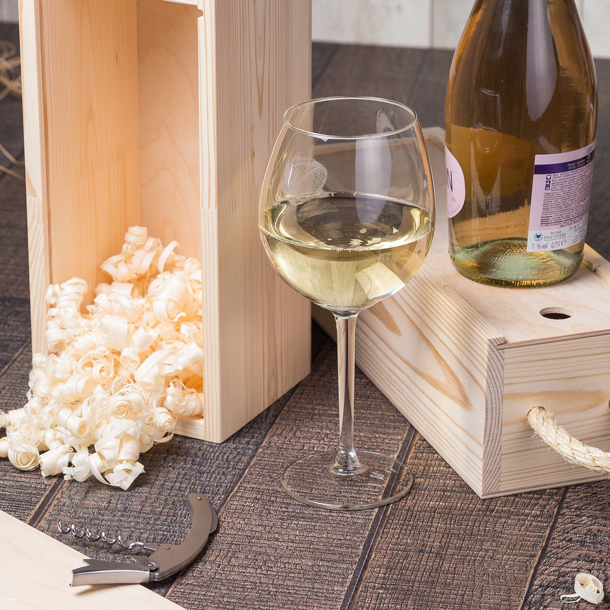 High Angle View Of White Wine With Sawdust In Box