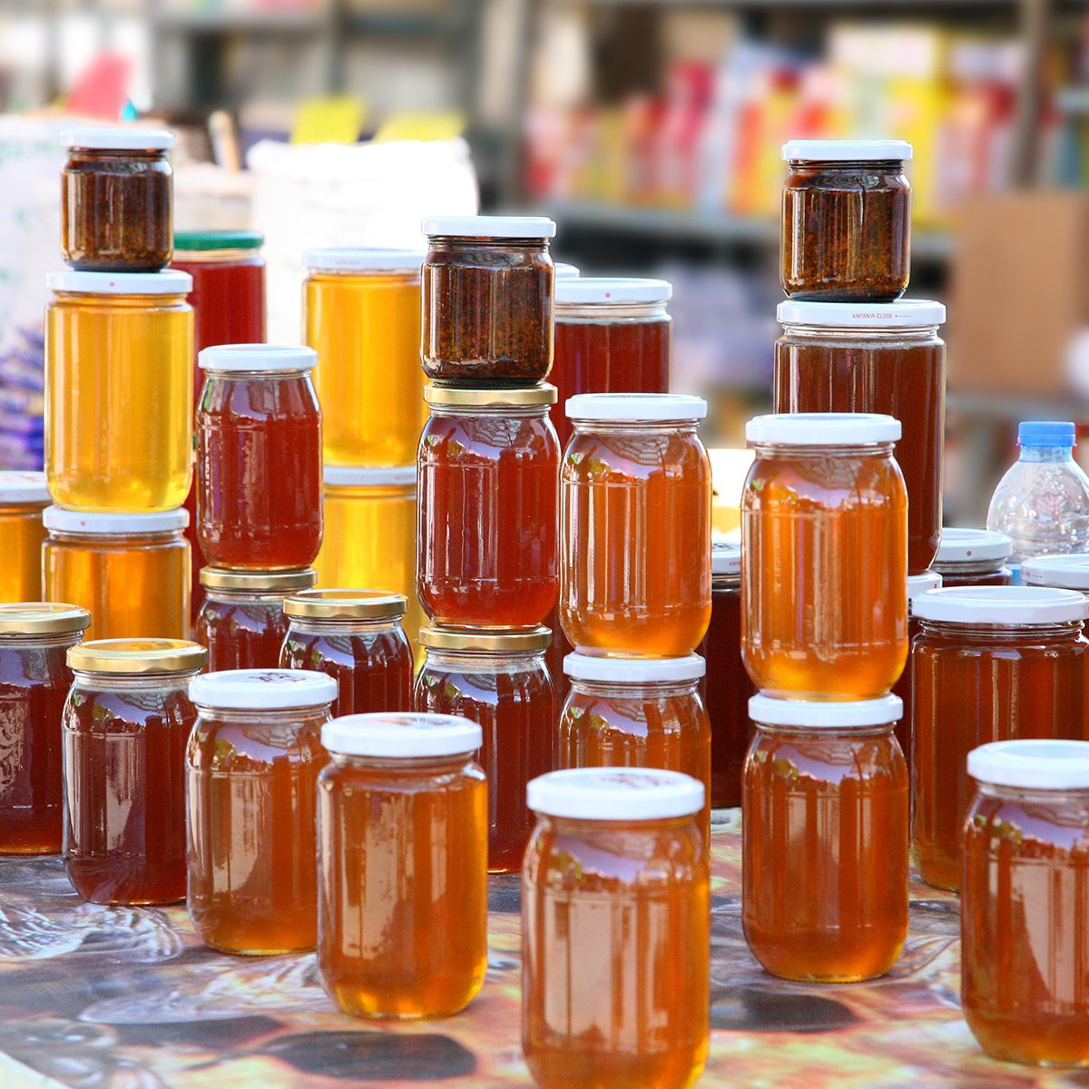 Jars of honey on display for sale.