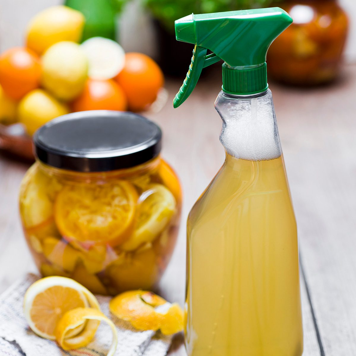 Homemade cleansing agent, vinegar, peels of citrus fruits, ginger and water