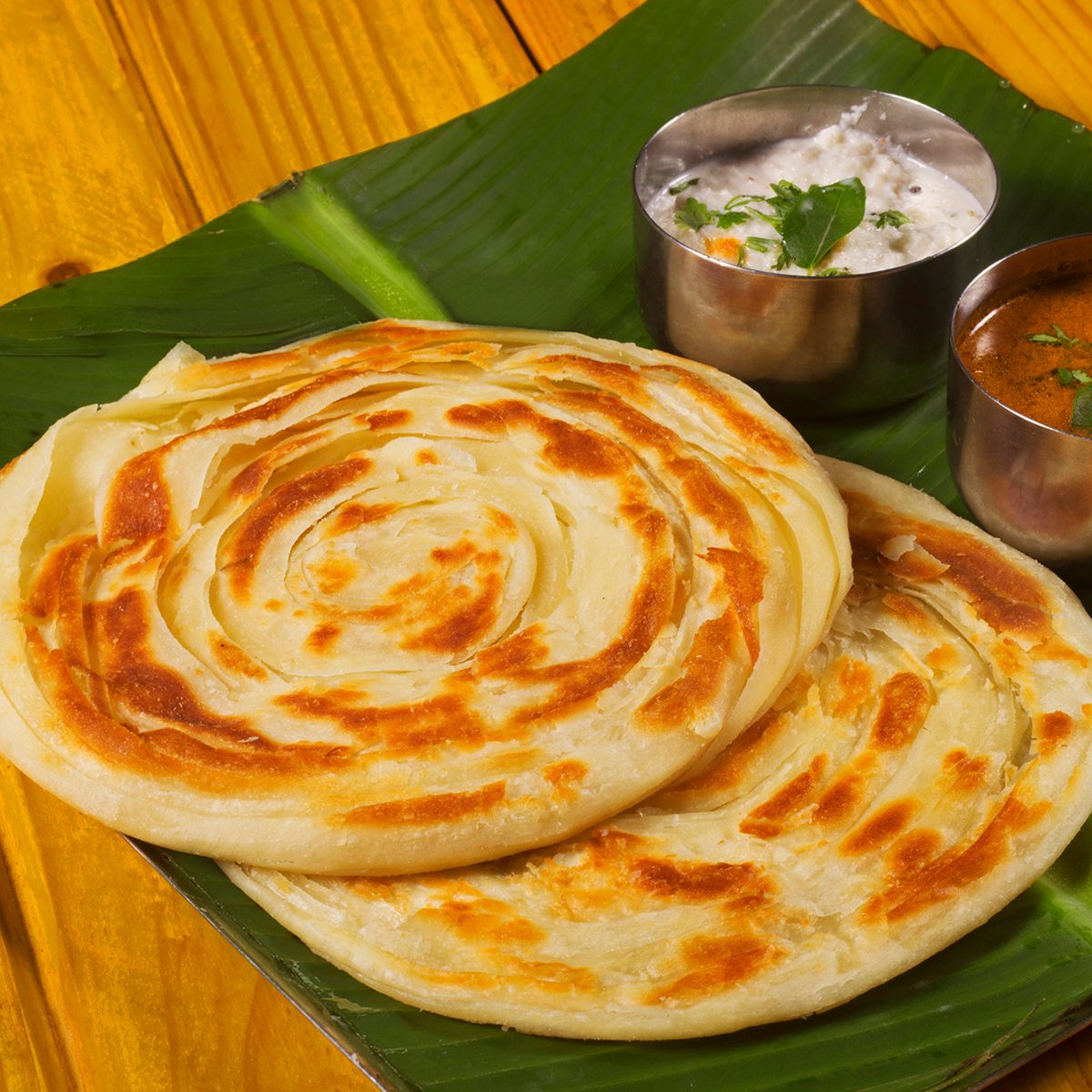 Kerala parotta, popularly known as paratha or porotta, is a delicacy from the state of Kerala