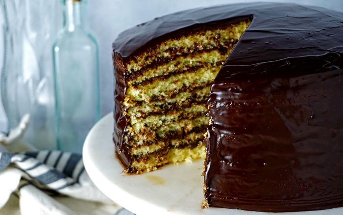 smith island cake with a slice removed to show the layers of cake and fudge