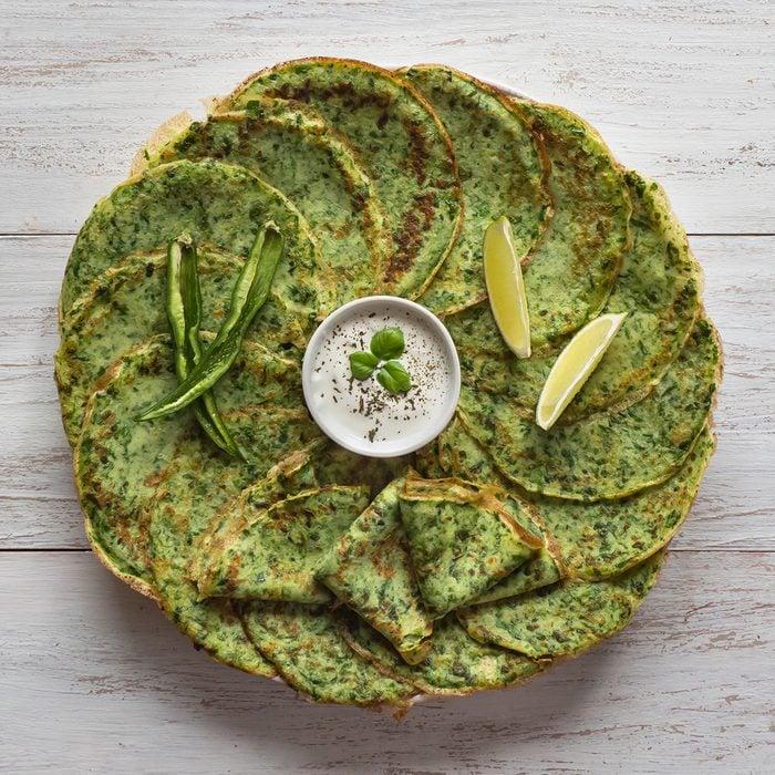 Spinach Adai - Indian green pancakes. Handmade food.