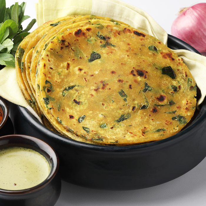 Methi Paratha (Thepla) / Indian flat bread using fenugreek leaves, served with mint dip,yogurt.
