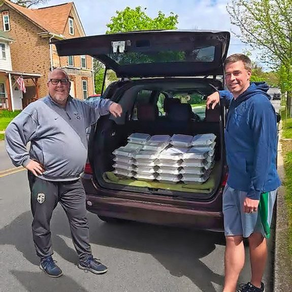 Scott and Jeremy deliver dozens of cookies to front-line workers each week.