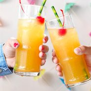 Nutty Hawaiian; straight on camera angle; white background; shiplap; beverage; beverages; tropical; hawaiian; island; festive; party; refreshing; Southern Comfort; coconut rum; amaretto; pineapple juice; Maraschino cherries; hands; copy space; opener