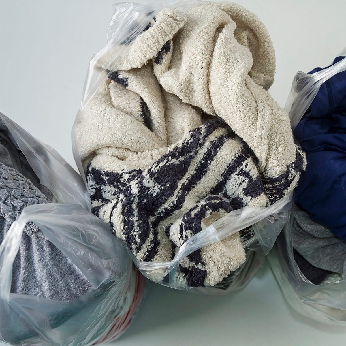 Everyday clothes packed in plastic bags