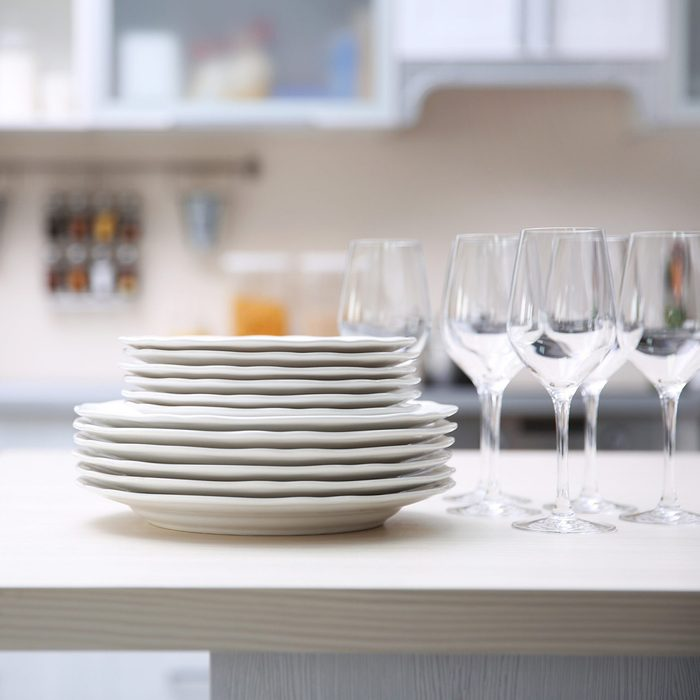stack of clean plates with glasses