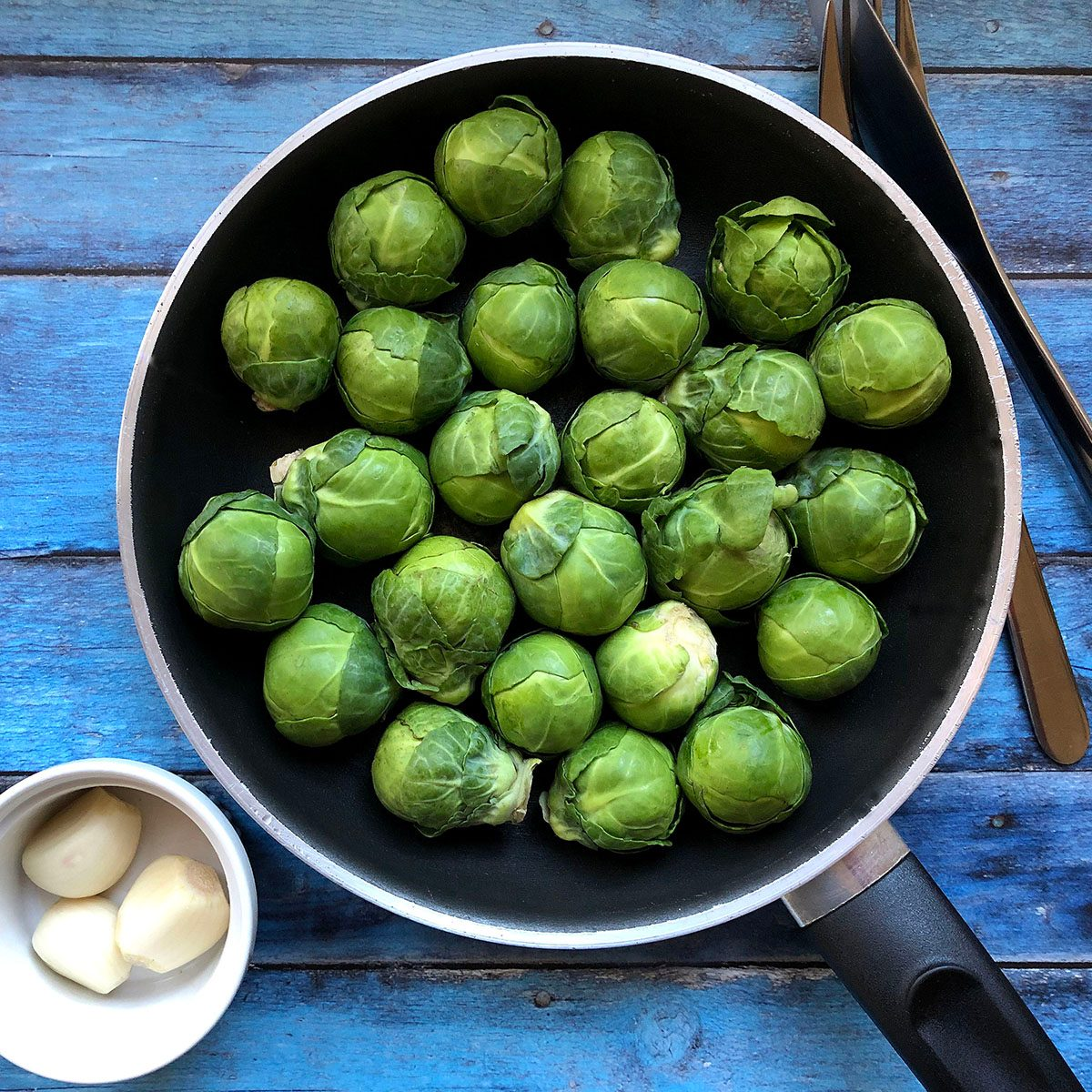 High Angle View Of Brussels Sprout In Frying Pan On Table