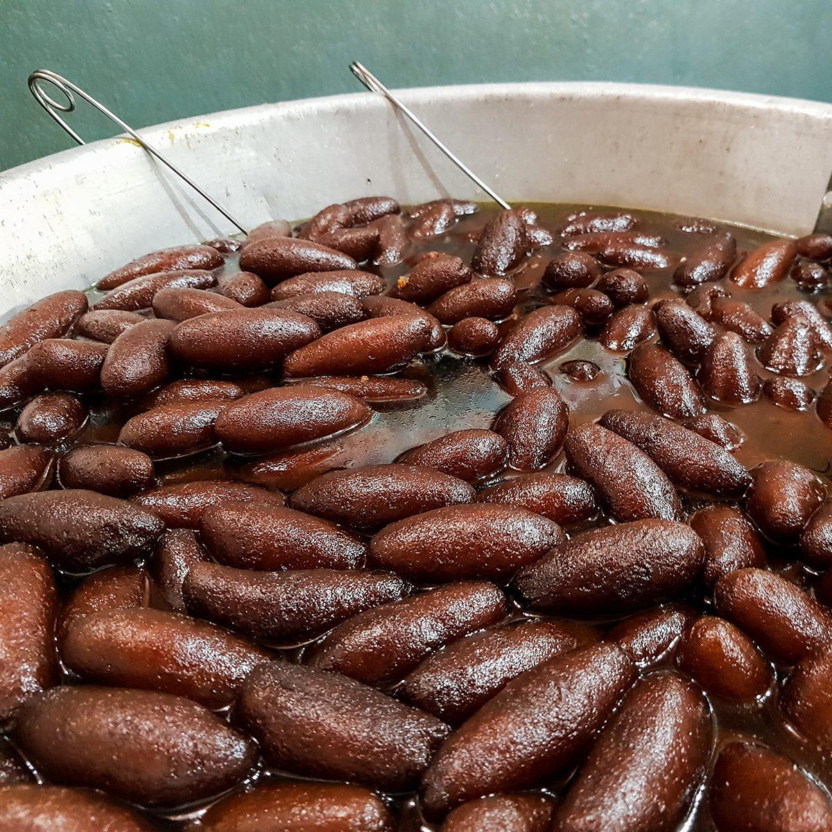 fried long sweet lyancha of shaktigarh dipped in sugar syrup. lengcha