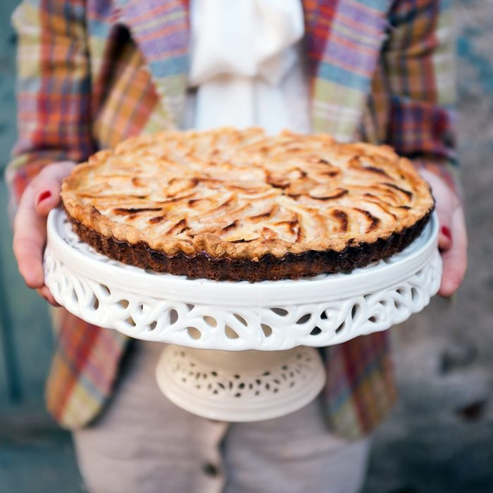 Person holding out a pie