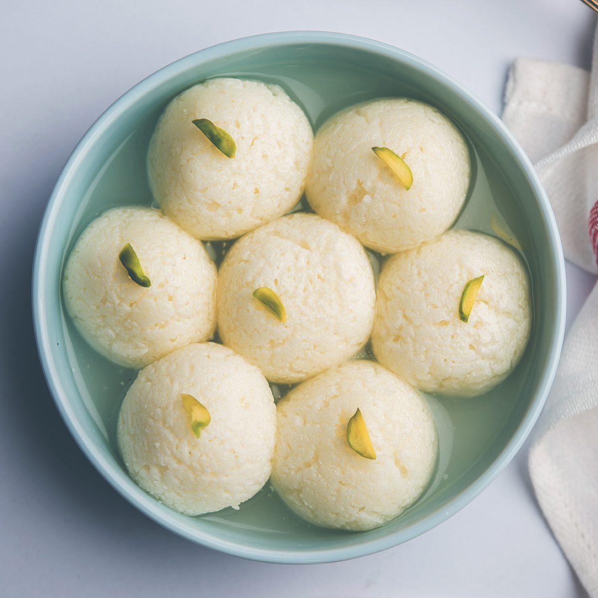 Indian Rasgulla or Rosogulla dessert/sweet served in a bowl. selective focus