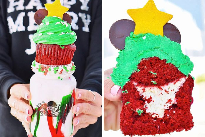 Disney Cookie Butter Milkshake is topped with a Red Velvet Christmas Tree cupcake with cream cheese filling and Holiday Sprinkles decor