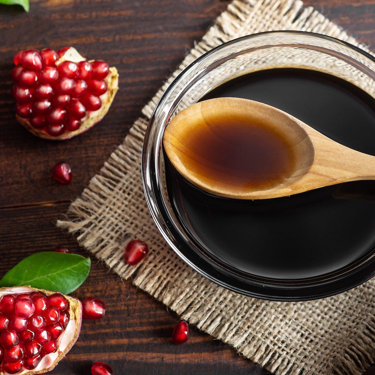 Pomegranate molasses in a glass bowl.