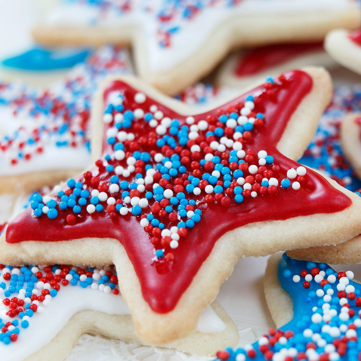 Star sugar cookies decorated for 4th of July Independence day celebration in America. Icing and sprinkles in red, white, and blue.
