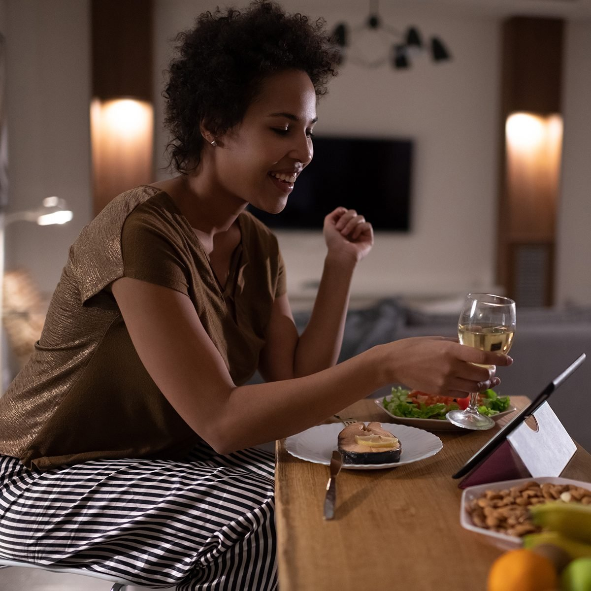 Black Female Proposing Toast To Online Friends