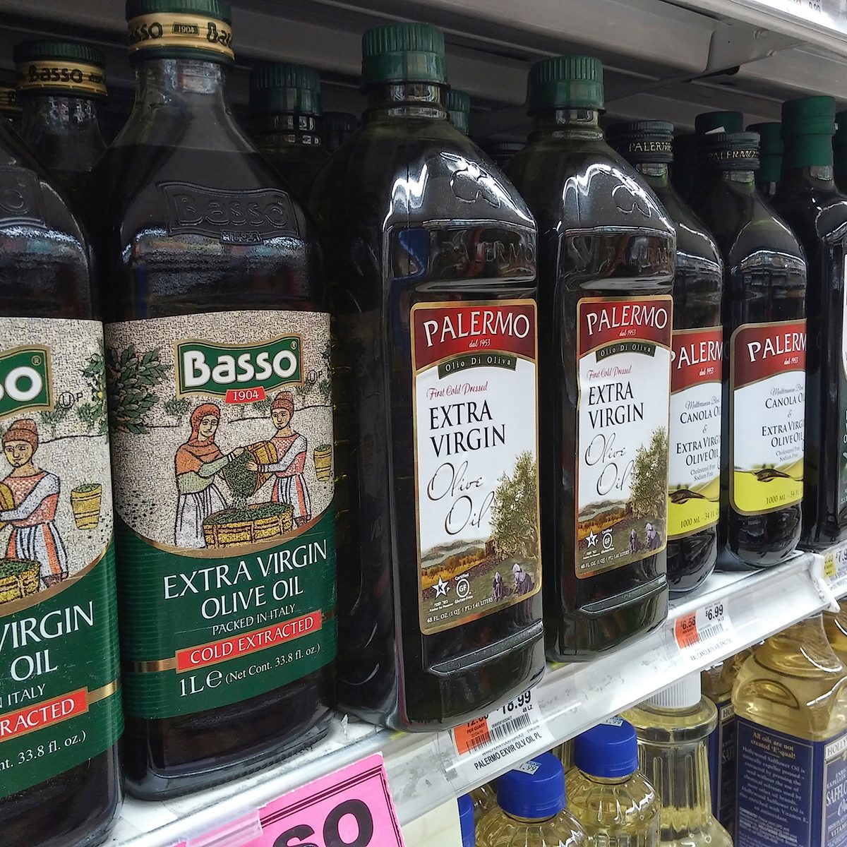 healthy oils Bottles of imported olive oil and olive oil blends are seen on a supermarket shelf in New York on Monday, March 21, 2016. (© Richard B. Levine) (Photo by Richard Levine/Corbis via Getty Images)