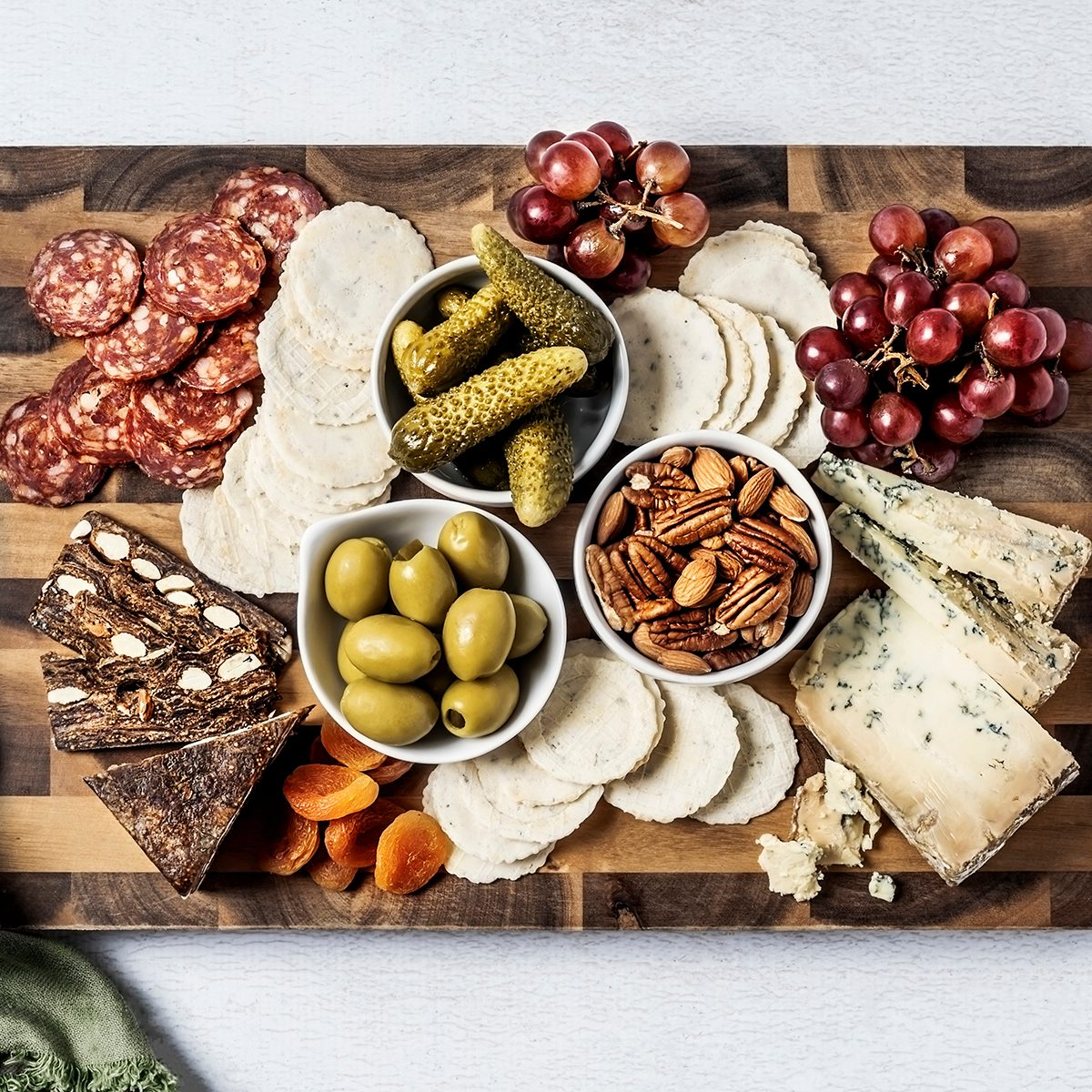 cutting board hacks: Cheese board on white background