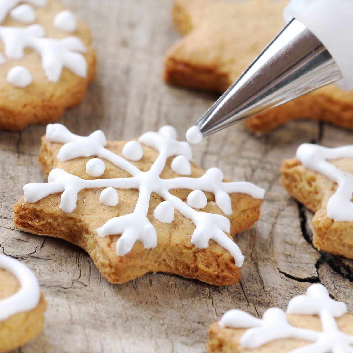 cookie decorating tips Christmas cinnamon cookies icing decorating process with a pastry bag