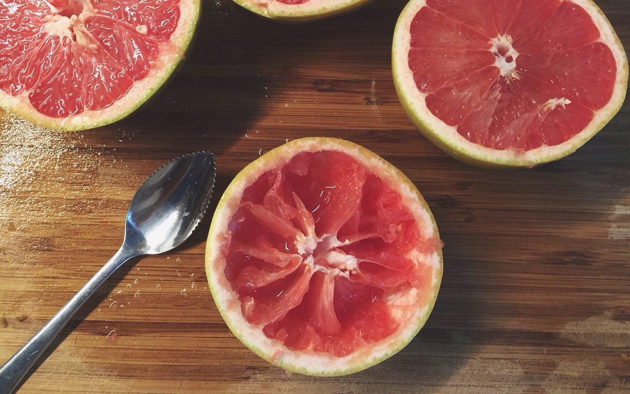 grapefruit spoon Halved Pink Grapefruit On Table