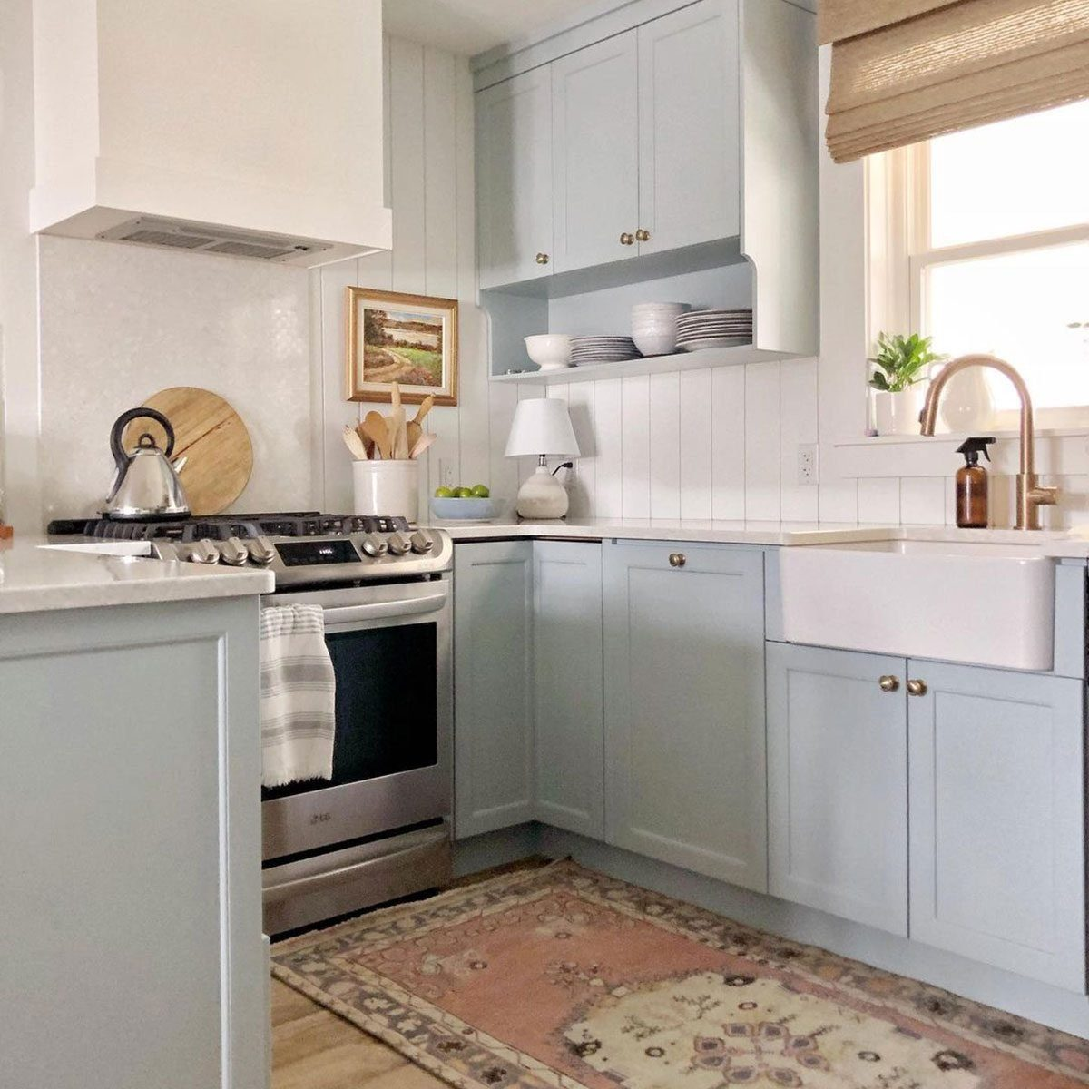 Kitchen with light blue cabinets