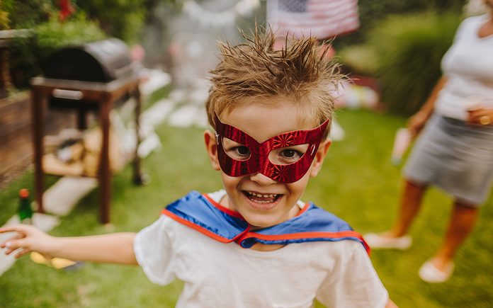 Superhero Birthday Party Photo of a little superhero in the yard during Fourth of July celebration