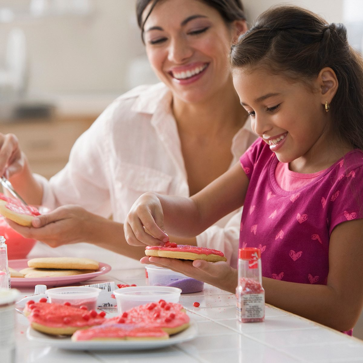 Mother And Daughter Making Valentine's Cookies