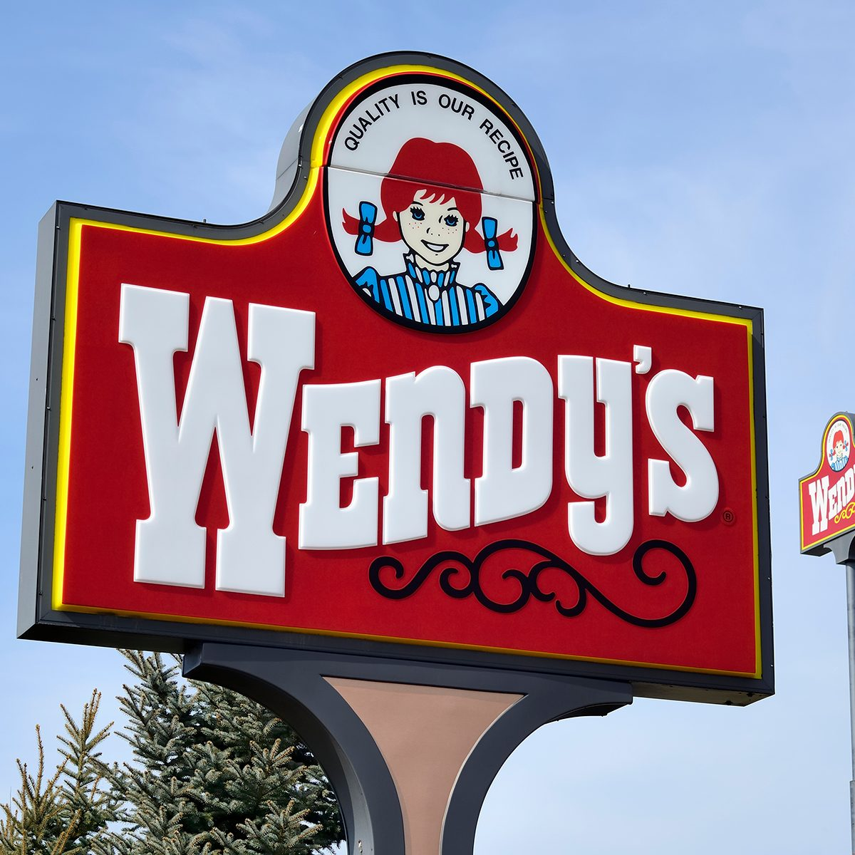 """""""Clio, Michigan, USA - March 7, 2012: The Wendy's location in Clio, Michigan. Founded in 1969 by Dave Thomas, Wendy's is a chain of fast food restaurants with over 6,600 locations in the US and abroad."""""""