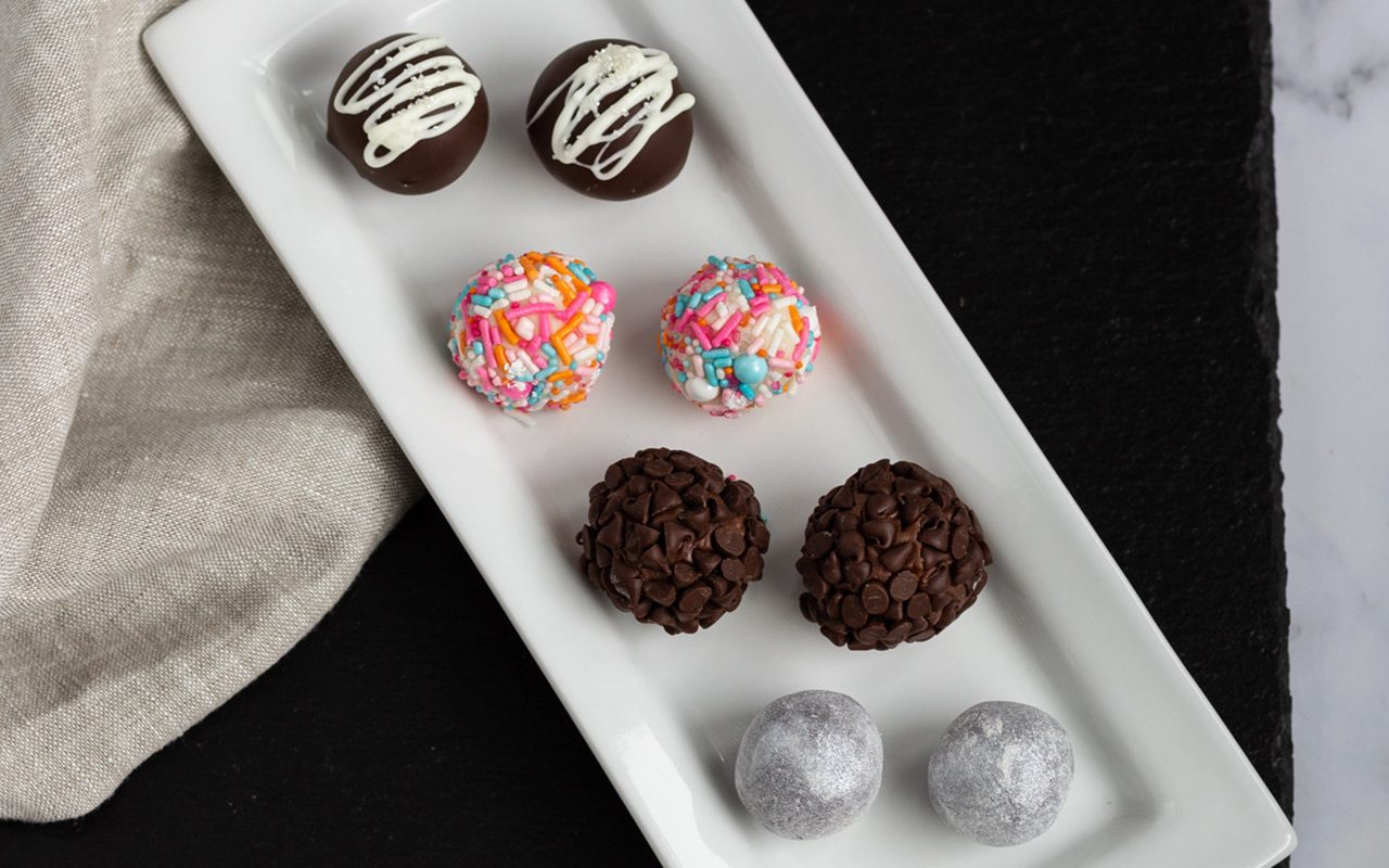 Long white tray of chocolate truffles. How To Make Chocolate Truffles.toh.nancy Mock 5