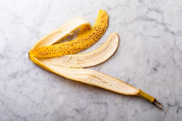 Banana peel on marble background