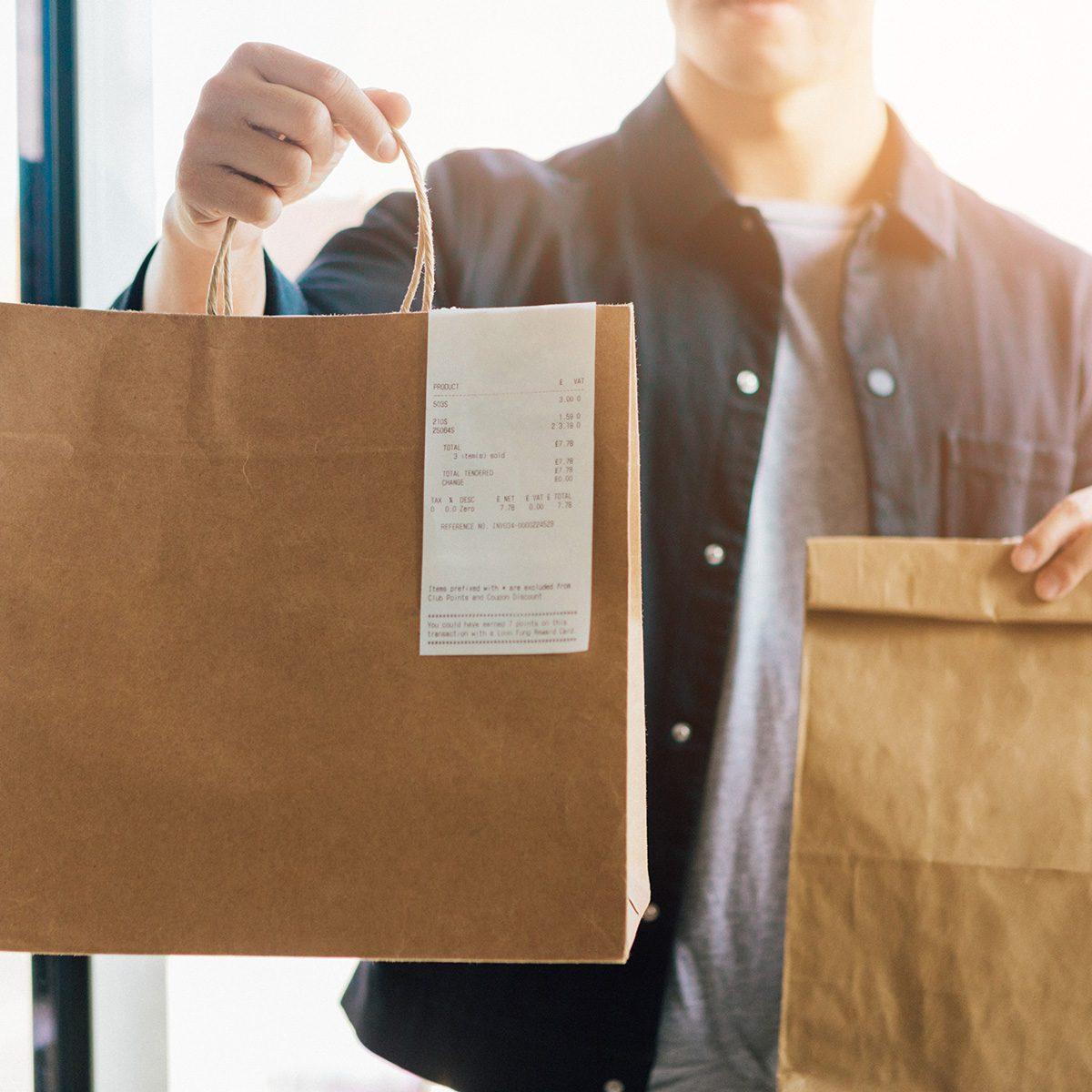 Man Delivering Takeaway Food At The Front Door