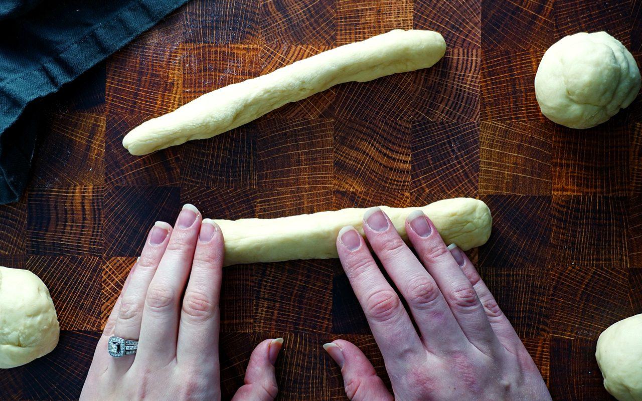 copycat olive garden breadsticks shaping breadstick dough into rods