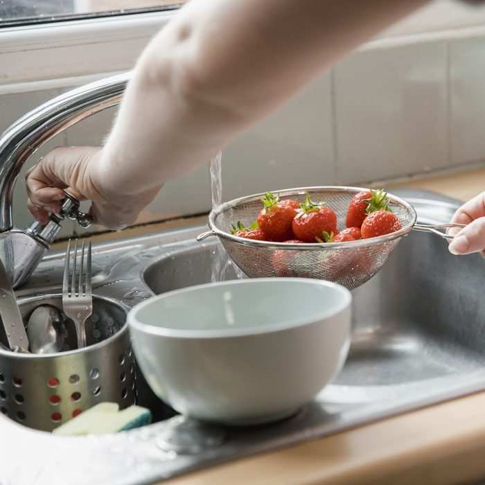 how to wash berries Rinsing Off The Strawberries