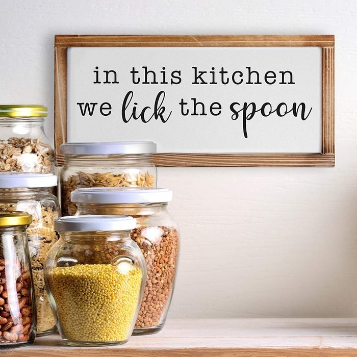 In This Kitchen We Lick The Spoon Sign